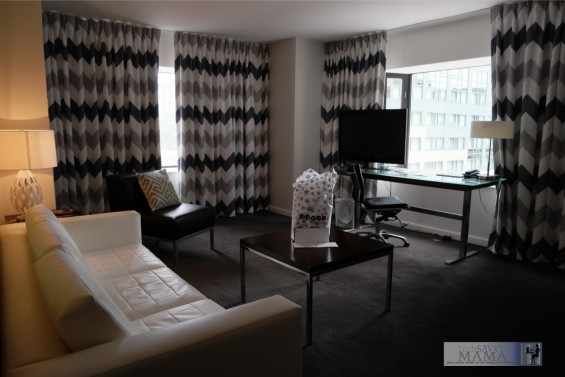Brookshire Suites Baltimore Living Area: Learn how you can give back to Baltimore by staying at this centrally located Inner Harbor hotel on TechSavvyMama.com